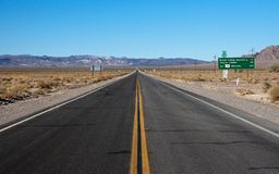 Long highway through desert Stock Photo
