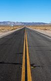 Long highway through desert Royalty Free Stock Photography