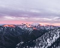 Lovely skies over Snowy Mountain Peaks royalty free stock image