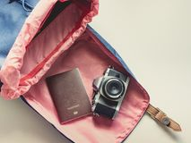 Long holiday travel flat lay concept from blue backpack and lath. Er strap for man with retro camera and passport put on  white background Stock Images