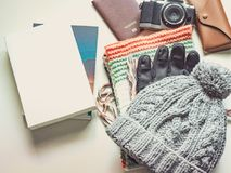 Long holiday and winter season travel flat lay concept from wint. Er cloth item and passport , retro camera , sunglasses and book put on  white background Royalty Free Stock Photo