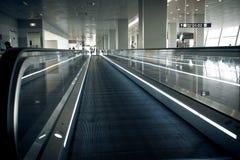 Long horizontal escalator at international airport terminal Stock Photos