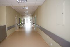 Long hospital hallway. With exit at the end Stock Photography