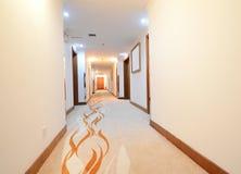 Long hotel corridor Stock Photos