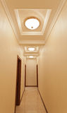 Long hotel corridor with light Royalty Free Stock Images