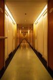 Long hotel hallway. White doors in Hotel Corridor Stock Photo