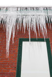 Long Icicles on a Gutter Royalty Free Stock Image