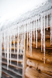 Long Icicles Melting of a roof top Stock Photography