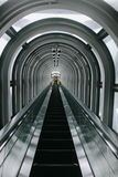 Long and illusion escalator in the skyscraper Royalty Free Stock Images