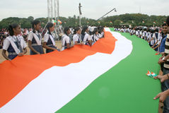 Long Indian National flag being carried by School Children Royalty Free Stock Photos