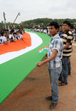 Long Indian National flag being carried by School Children Stock Photos