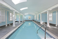 Long indoor swimming pool Stock Photography