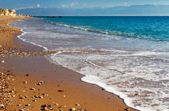 Long and inviting sandy beach in the Mediterranean Royalty Free Stock Photos