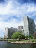 Long Island City. New York City, Long Island, USA - June 8, 2014: People having a rest by East river in Long Island City park in Queens, New York Royalty Free Stock Photography