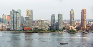 Long Island City in NYC. New York, USA - Sep 21, 2016: View of Hunters Point in Long Island City from the United Nations headquarters. Historic billboard of stock photo