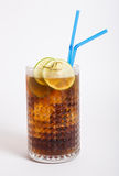 Long island iced tea. In a glass with straw royalty free stock image