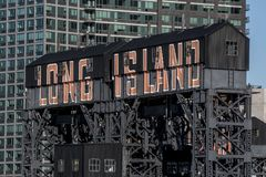 Long Island sign on a building. The words Long Island painted on the side of a raised wooden building in Long Island City, New York Stock Photography