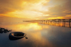 A long jetty and golden light Stock Images