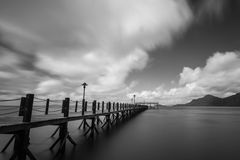 Long Jetty. With turquoise water in black and white Royalty Free Stock Image