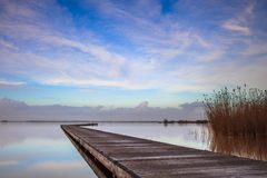 Long jetty Zuidlaardermeer on a cold day Stock Photo