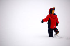 Long Journey. Two year old boy walking in deep snow Royalty Free Stock Image
