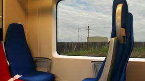 Long journey by rail Window view. View from the window quickly riding the train stock video footage