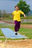 Long jump. 11 year old girl  Long Jump practice Royalty Free Stock Photo