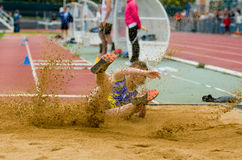 Long jump. Person  at long jump in stadium Royalty Free Stock Images
