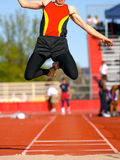 Long-jump. Long jumper in the air before landing in long-jump pit Royalty Free Stock Photography