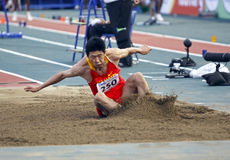 Long jump china. MONCTON, CANADA - JULY 20: Kai Yang of China competes in the long jump during the 2010 IAAF World Junior Championships on July 20, 2010 in stock photos