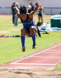 Long Jump. A female athlete makes a long jump and shows good form at this track meet in Redding, California April 26, 2014 Stock Image