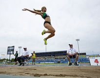 Long jump female sky canada Stock Photo