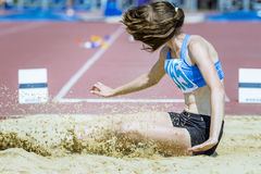 Long jump girl Stock Photos