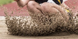 Long jump. In landing in track and field Royalty Free Stock Image