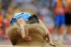 Long Jump. Man jumps in sand, long jump Stock Images