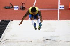 Long Jump Man MICHEL TORNEUS Stock Photography