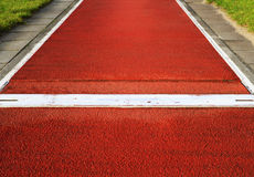 Long jump spring plank in an outdoor stadium Royalty Free Stock Images