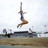 Long jump woman leap sky canada Stock Photography