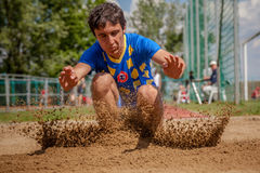 Long jumper in action Stock Images