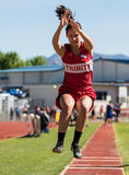 Long Jumper. City of Shasta Lake, California. Track and field action at the Burt Williams Track and Field Classic Royalty Free Stock Photos