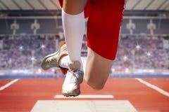 Long jumper jump into sand box Royalty Free Stock Photo
