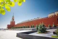 Long Kremlin wall view with Spasskaya tower Stock Photos