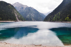 Long Lake is dark blue at Jiuzhaigou, China. Royalty Free Stock Photography