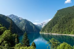 Long lake, one of many famous lakes in Jiuzhaigou during July. stock photography