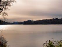 Long Lake sundown with seaplane taking off Royalty Free Stock Photos