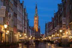 Long Lane in Gdansk at dusk. View of the Main Town Hall and tourists and local people strolling on the Long Lane at the Main Town Old Town in Gdansk, Poland, in Stock Photography