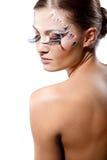 Long lashes. Fashion make-up with face art and extra long lashes. Model isolated on white background stock image