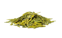 Long leaves green loose  tea,  isolated. Long leaves green loose  tea Dragon well,  isolated on white Royalty Free Stock Photos