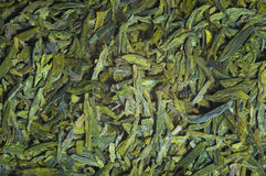 Long leaves green loose  tea,  texture. Long leaves green loose  tea Dragon well,  background, texture Stock Photo