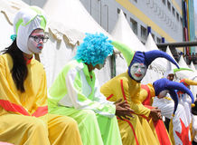 Long Leg Clowns. Jakarta, Indonesia - February 21, 2016: Long leg clowns have talking each other when waiting to perform in Cap Go Meh carnival which held in Stock Images